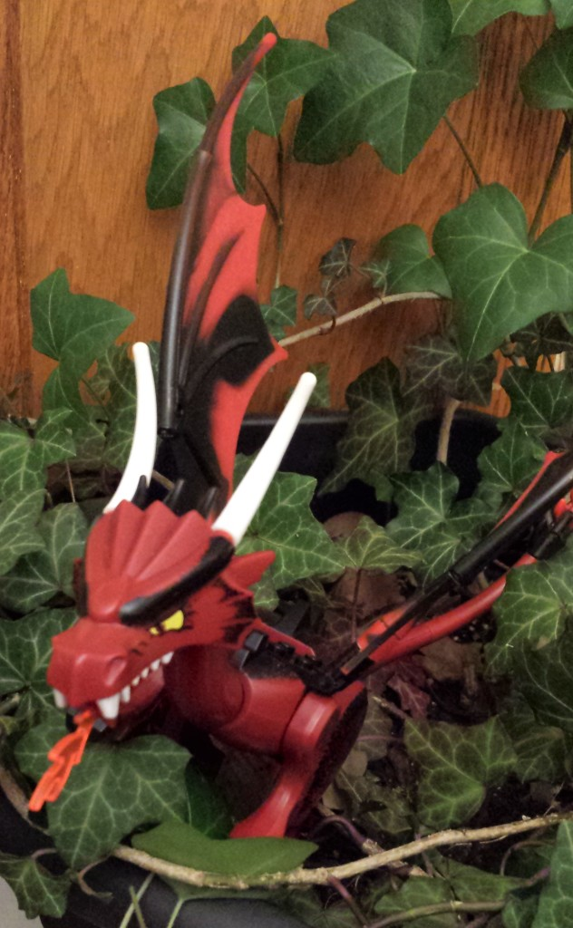 Toy dragon in ivy plant